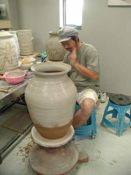 Forming pot on wheel.